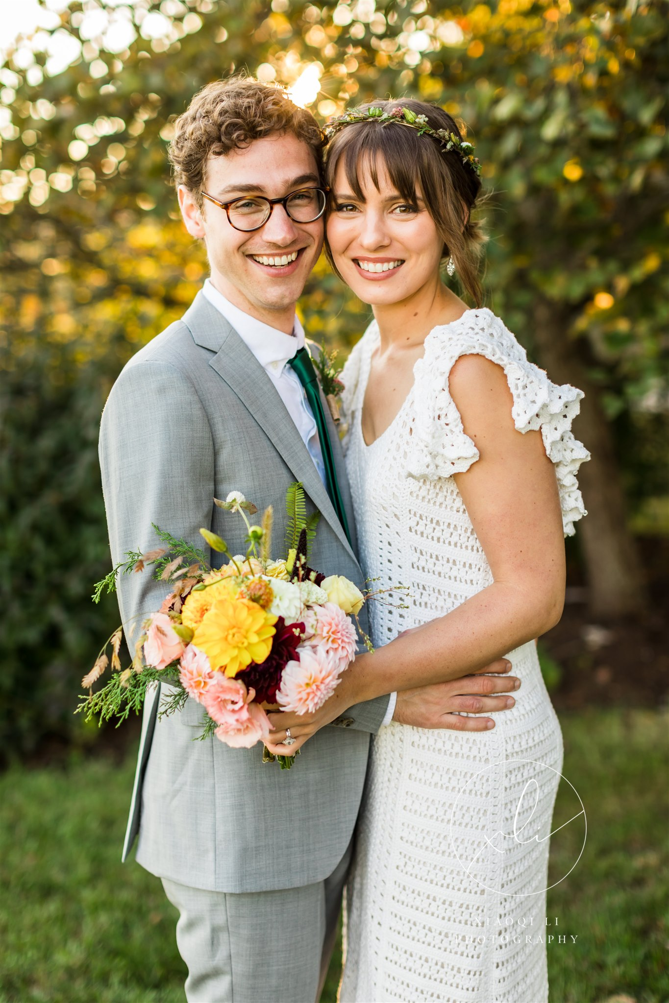 newly married couple hugging and smiling on wedding day