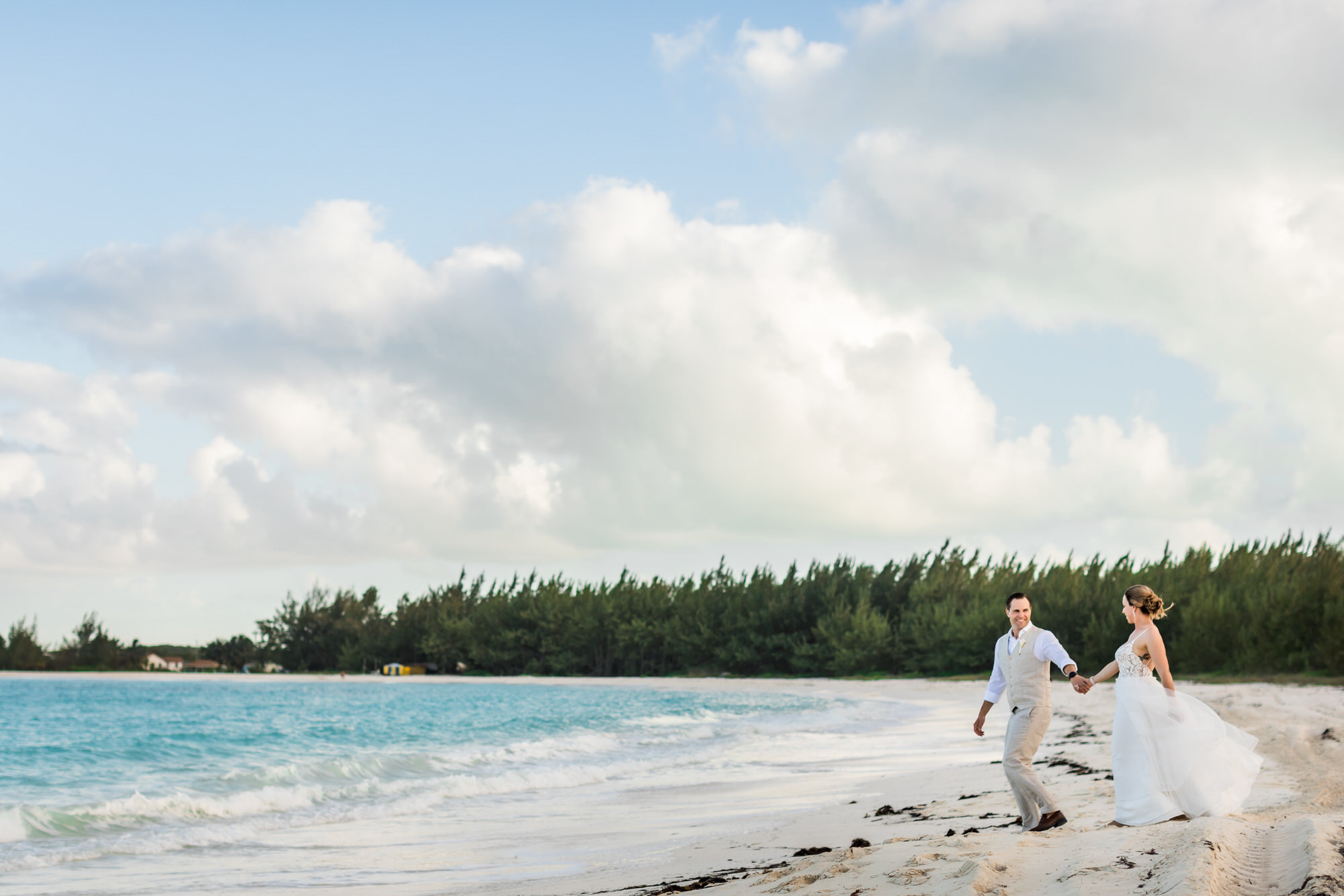 Newly married couple walking together after micro wedding in Bahamas