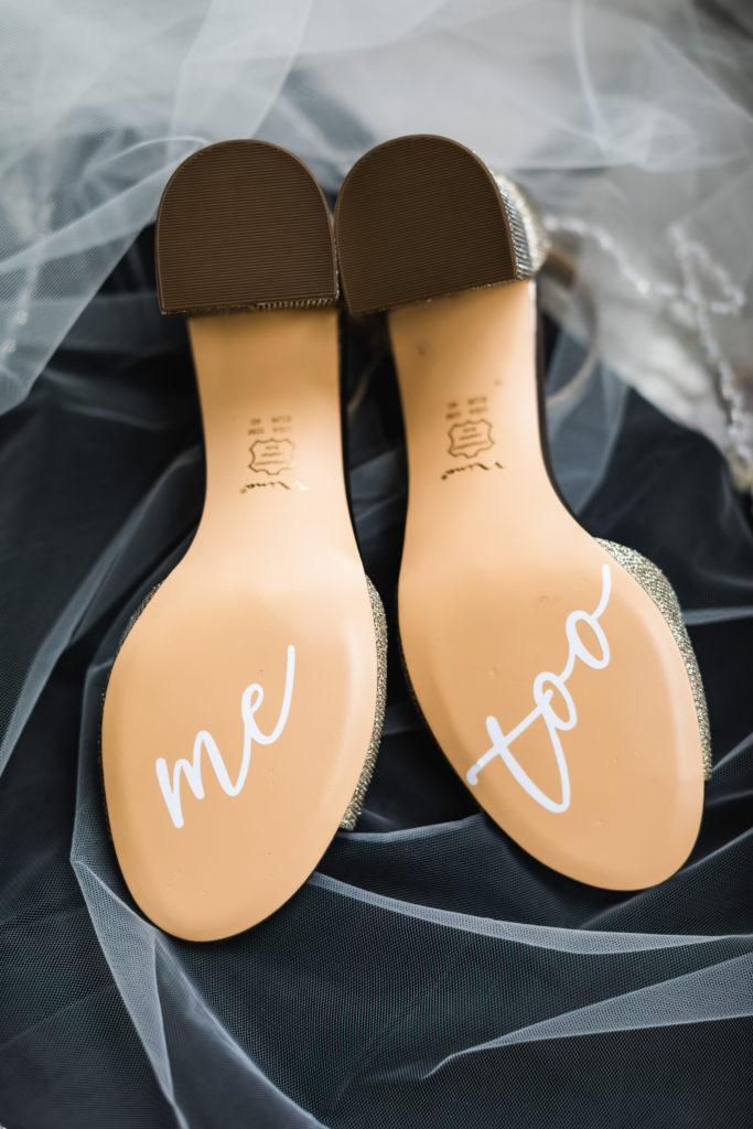 bride's personalized wedding shoes with 'me too' written on soles