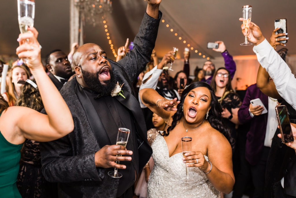 bride and groom dancing and celebrating recent wedding ceremony
