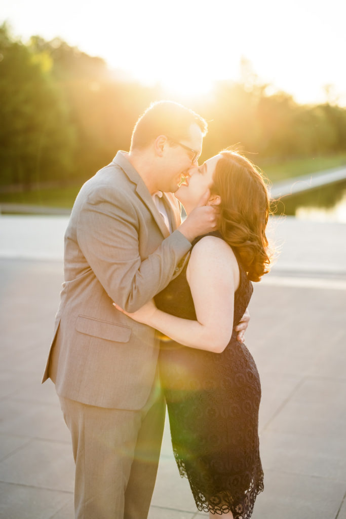 engaged couple kissing at sunset during engagement session in Washington DC
