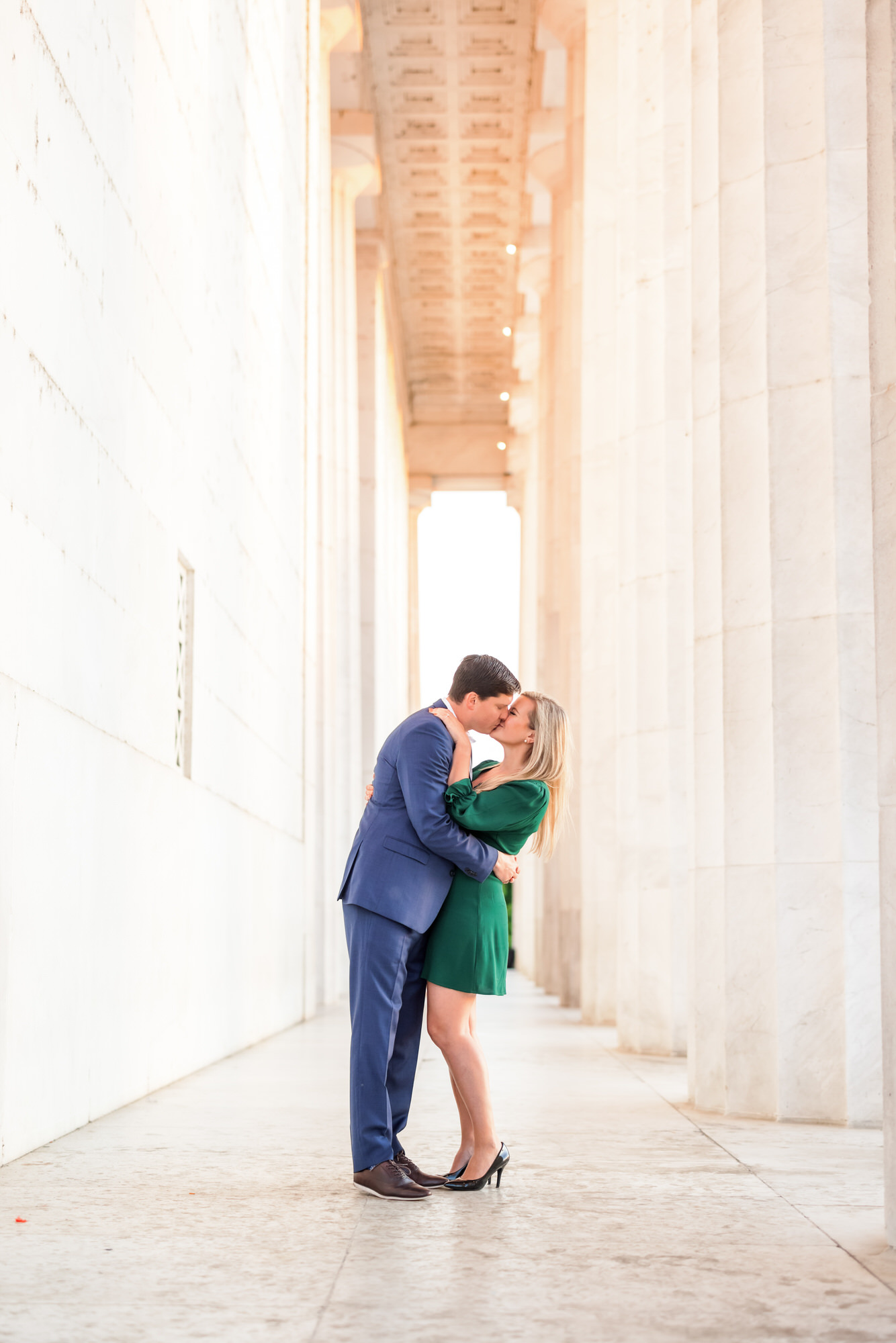 engaged couple kissing at Lincoln Memorial during sunrise engagement session